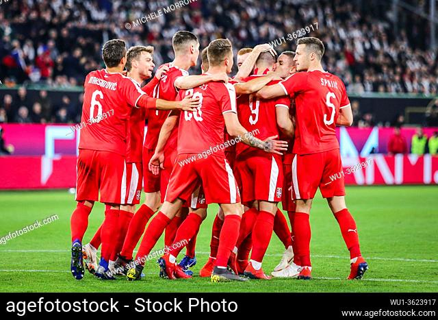 Wolfsburg, Germany, March 20, 2019: Serbian national team celebrating a goal during the international soccer game Germany vs Serbia in Wolfsburg
