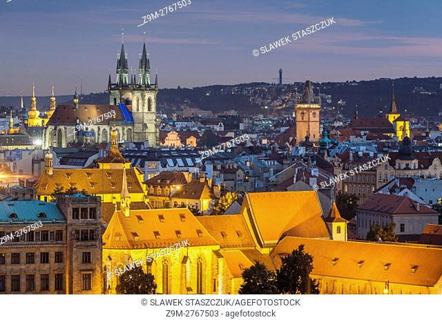 Night falls in Prague old town, Czech Republic. . The medieval church of Our Lady before Tyn dominates the city skyline