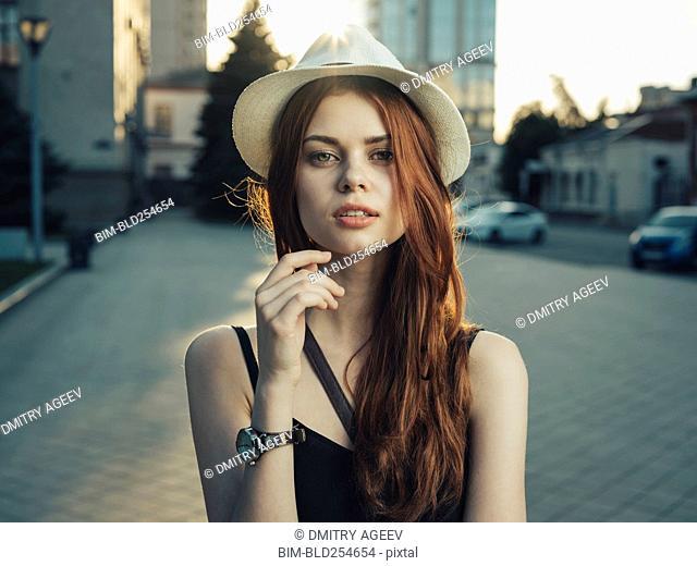 Serious Caucasian woman in city