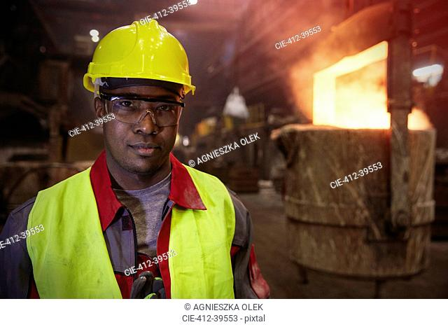 Portrait serious, confident steelworker in steel mill
