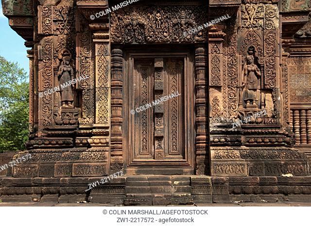 Carvings around temple doorway in Banteay Srei in Angkor in Cambodia