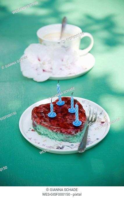 Heart shaped birthday cake and coffee cup with flowers