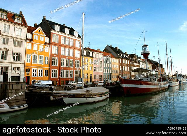 House by the canal one early morning in Nyhavn, Copenhagen, Denmark