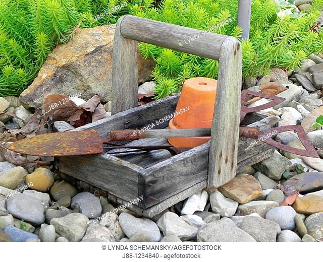 Garden tools in wooden carry basket