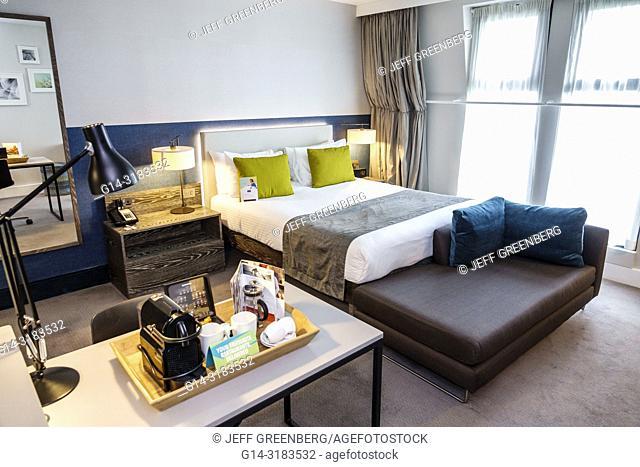 United Kingdom Great Britain England, London, Lambeth, Staybridge Suites London Vauxhall, hotel, guest room, bed, desk, clean room, coffee maker tray