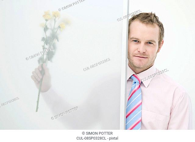 Business man with flowers