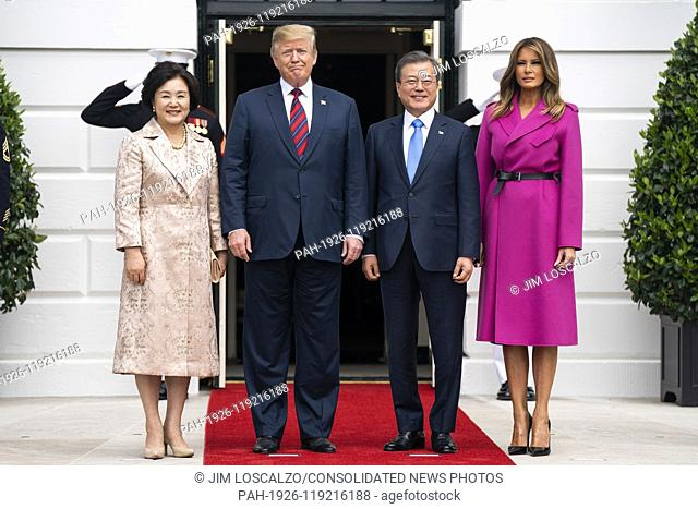 US President Donald J. Trump (C-L) and First Lady Melania Trump (R) welcome Korean President Moon Jae-in (C-R) and Mrs. Kim Jung-sook (L) to the South Portico...