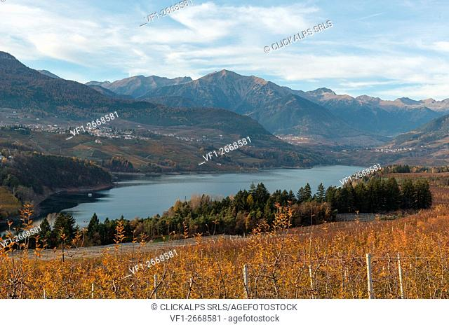 Italy, Trentino Alto Adige, play of light on the St. Giustina lake in Non Valley on a cloudy day