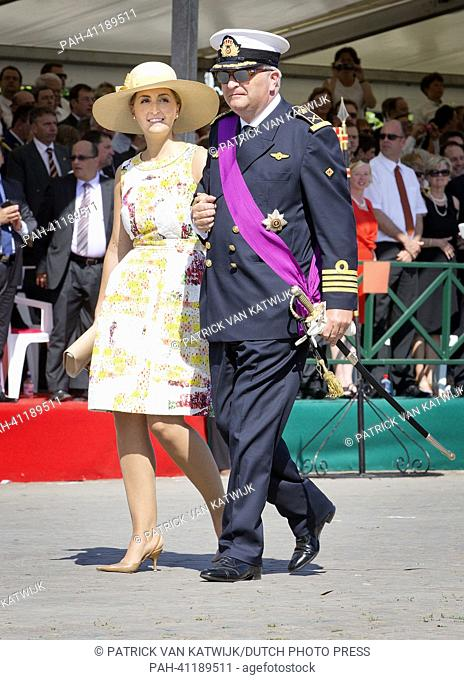 Prince Laurent and Princess Claire reviews the civil and military troops at the front of the Royal Palace in Brussels, Belgium, 21 July 2013