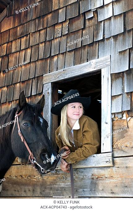 Cowgirl and her horse, Kamloops, British Columbia, Canada