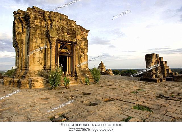 Phnom Bakheng Temple. Sunrise. Phnom Bakheng is located 1,30 meters (4,265 feet) north of Angkor Wat and 400 meters (1,312 feet) south of Angkor Thom