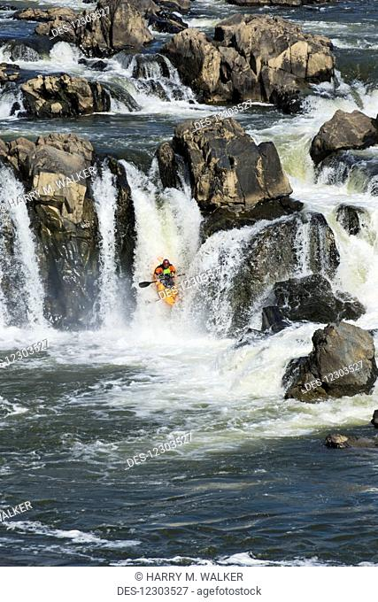 Whitewater kayaking down waterfall in the Potomac River, Great Falls Park; Maryland, United States of America