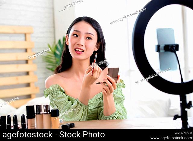 Young women live online makeup