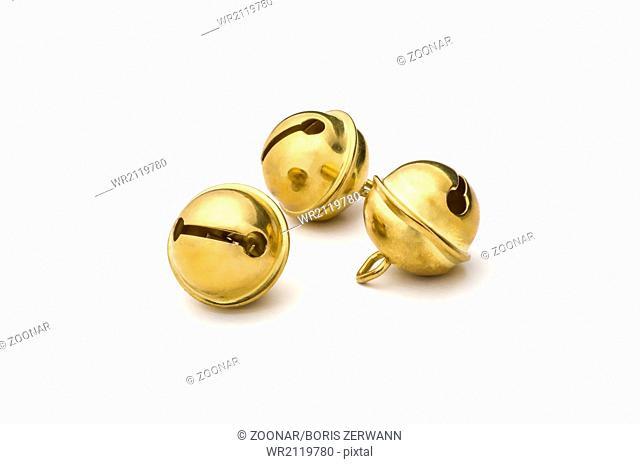 three golden sleigh bells