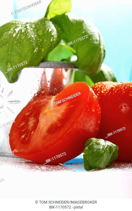 Tomatoes, one halved, with basil