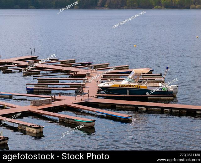 The jetties of a rental for leisure boats on the Rursee are deserted because of the corona crisis, Schwammenauel, Eifel, Germany