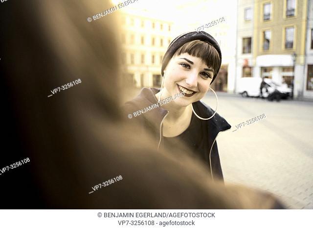 smiling woman, in city Cottbus, Brandenburg, Germany