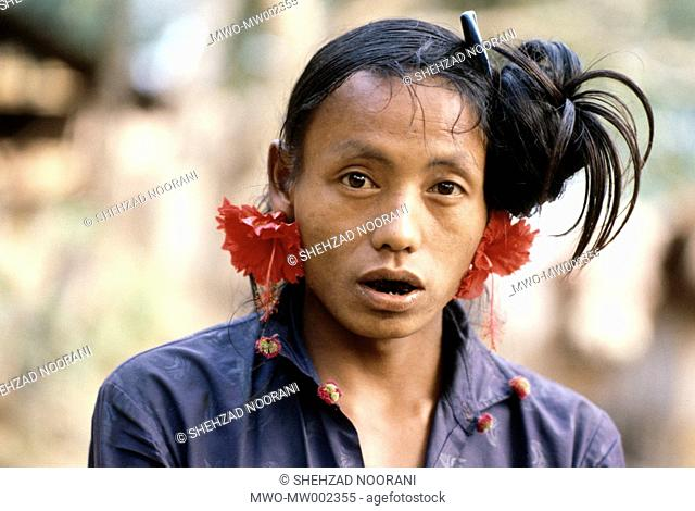 A Murong man with flowers in his ear It is common for Mru men to use flower as decoration or to beautify themselves Ali Kadam Bandarban District Chittagong Hill...