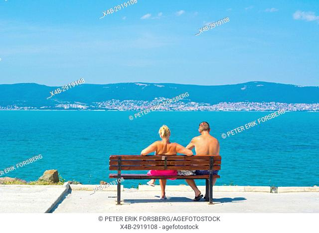 Tourists looking towards Sunny Beach, bridge between mainland and the peninsula, Nesebar, Bulgaria