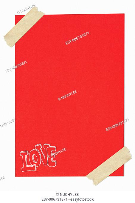 Handwriting love word on red paper with tape