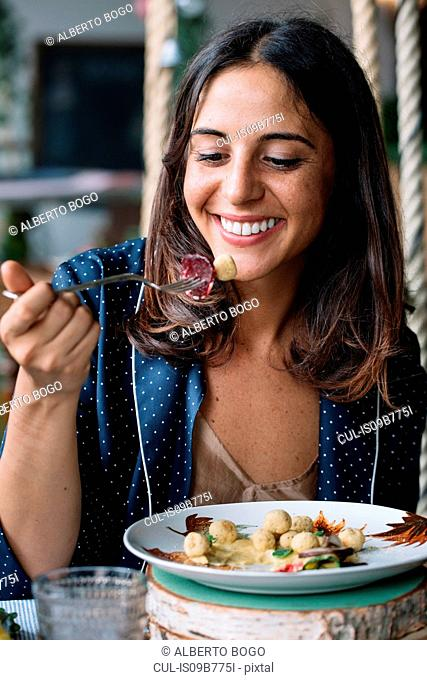 Woman enjoying vegetarian dish