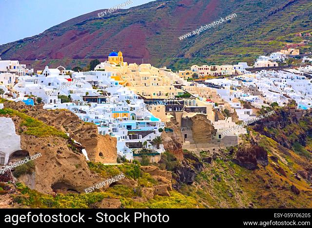 Santorini, Greece panorama of famous Fira village town with white houses and blue dome churches