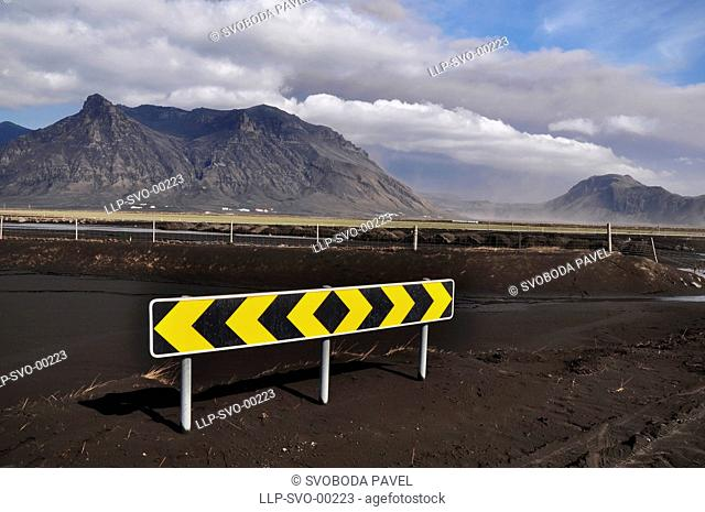 EYJAFJALLAJOKULL eruption, landscape covered by volcanic ash and the direction sign, picture taken from the ring road, south Iceland