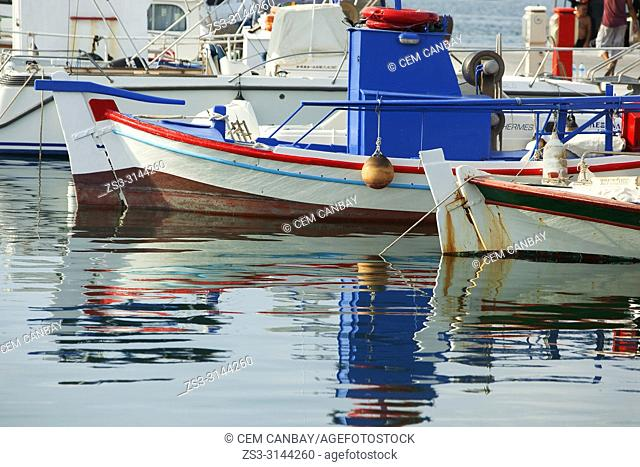 Traditional fishing boats and their reflections at the harbour of Parikia village, Paros Island, Cyclades Islands, Greek Islands, Greece, Europe