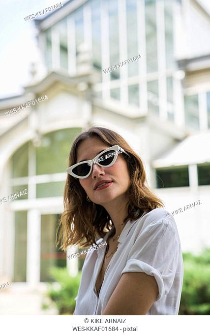Young woman sight seeing in Madrid, wearing sunglasses