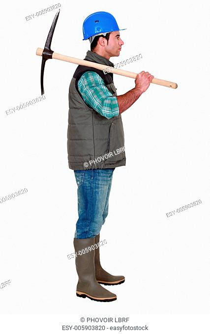 Construction working holding a pickaxe