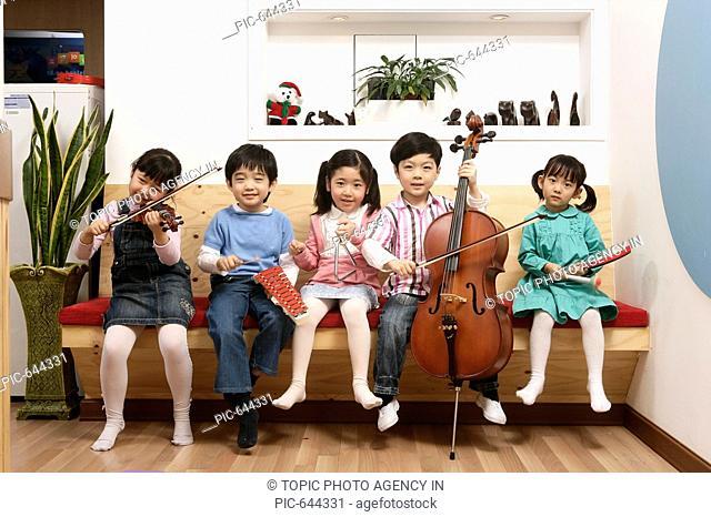 Korean Kids Playing Instruments in the Kindergarten