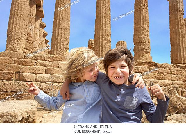 Portrait of brothers in front of the Temple of Concordia, Agrigento, Sicily, Italy
