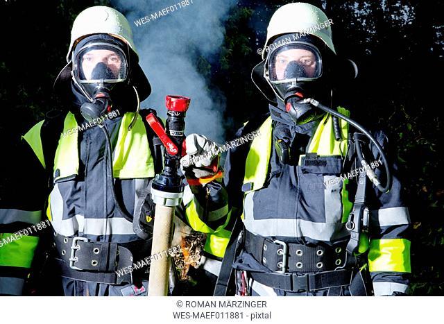 Two firefighters in uniform