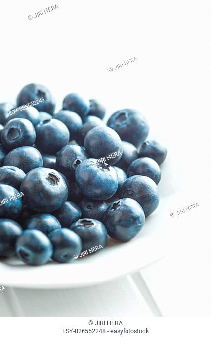 Tasty blueberries fruit in bowl. Blueberries are antioxidant organic superfood