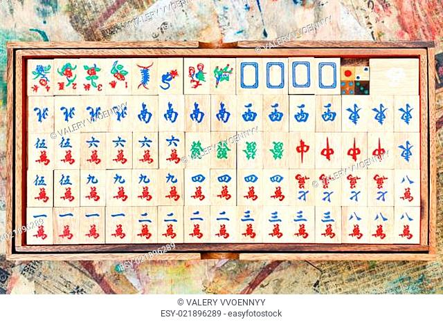 set of wooden mahjong tiles in box