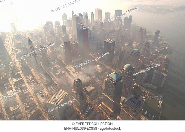 Aerial view of Ground Zero from the northwest on a hazy day, Oct. 4, 2001. At upper left is the Brooklyn Bridge, and at upper right is Governor's Island
