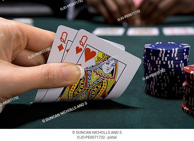 Close up of pair of queens in casino