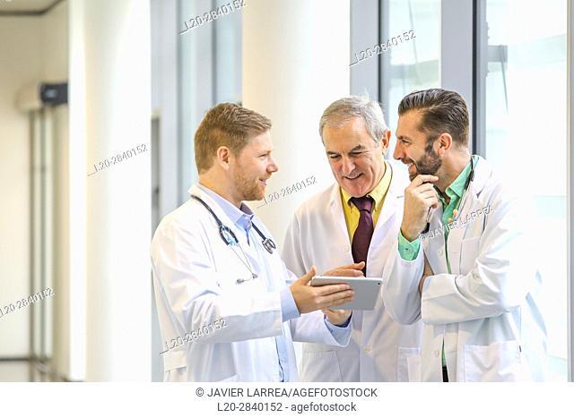Doctors talking in corridor, Hospital, Donostia, San Sebastian, Gipuzkoa, Basque Country, Spain