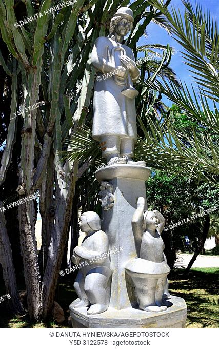 Statue in cactus part of Palmeral - Moorish date palm orchards - designated by UNESCO as a World Heritage Site, Elche, Elx, Alicante province