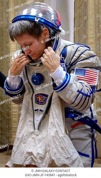 Expedition 50 NASA astronaut Peggy Whitson dons her Sokol suit ahead of her final qualification exams with fellow crew mates Russian cosmonaut Oleg Novitskiy of...