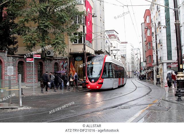 RED & GREY TRAM IN RAIN; ISTANBUL, TURKEY; 10/11/2012