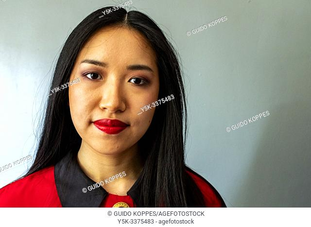 Tilburg, Netherlands. Close up studio portrait of a beautiful, Korean female student