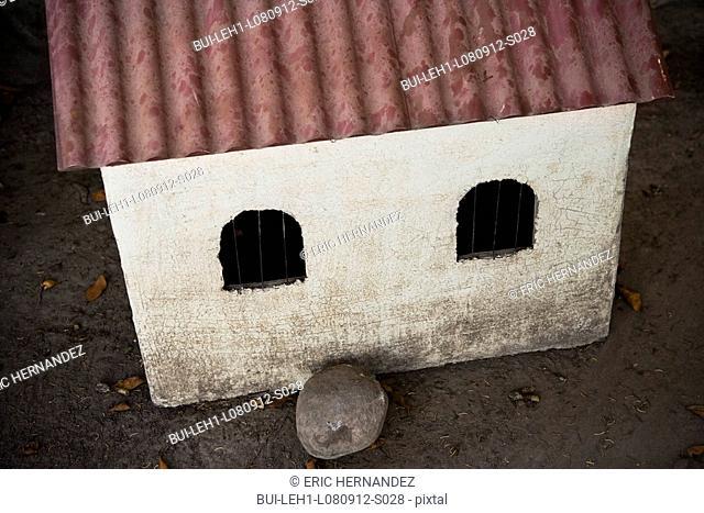 Mock red tile roof on dog house