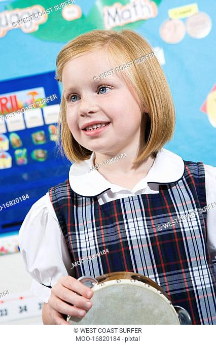 Elementary Student with Tambourine