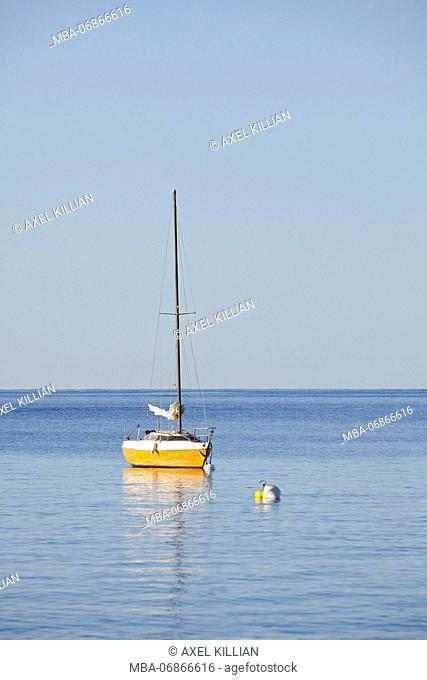 small sailboats with buoy anchoring in the sea