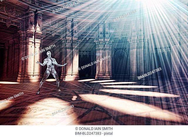 Futuristic man basking in light