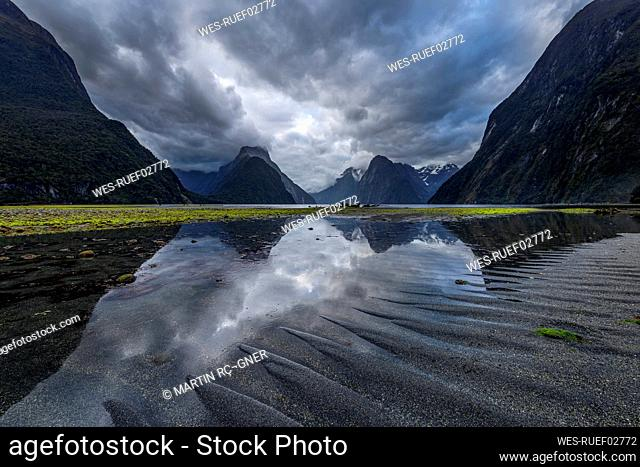 New Zealand, Southland, Storm clouds over scenic coastline of Milford Sound