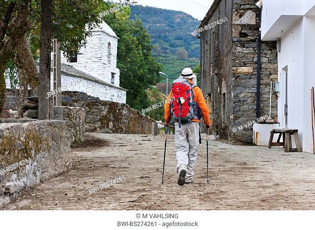 pilgrim on his way through the villge, Spain, Galicia, Lugo, Hospital da Condesa