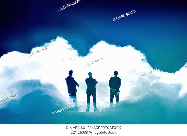Business concept based in cloud. Three silhouette of men between clouds
