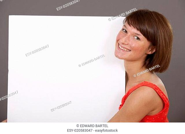 smiling woman with white banner